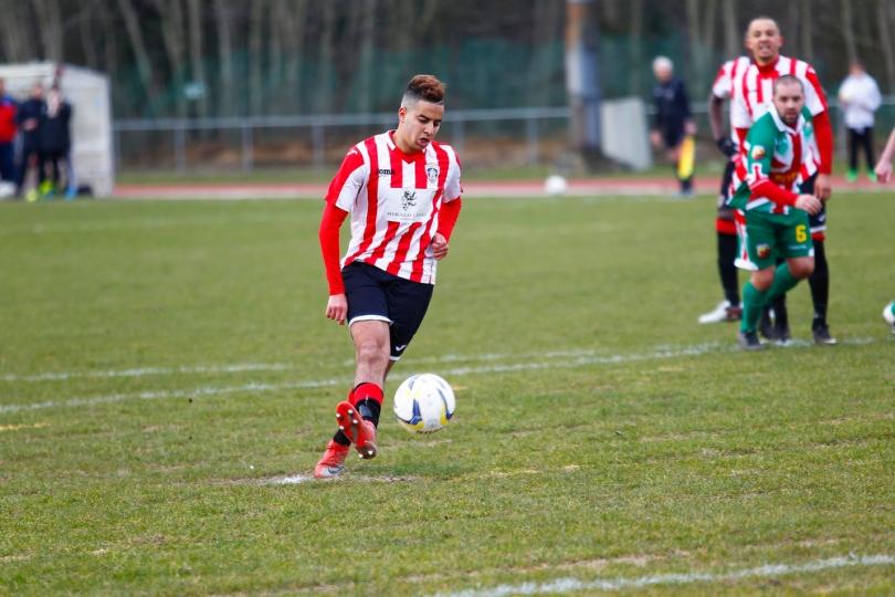 27/02/2016 Guildford City Fc v Windsor. Sanchez BENALI scores from the spot